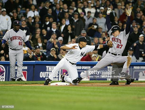 New York Yankees' Alex Rodriguez tags the Minnesota Twins' Justin Morneau out at third base in the first inning of Game 2 of the American League...