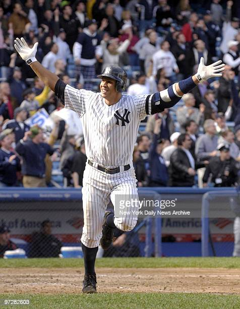 New York Yankees' Alex Rodriguez throws up his arms in celebration after hitting a threerun walkoff homer to center in the bottom of the ninth inning...