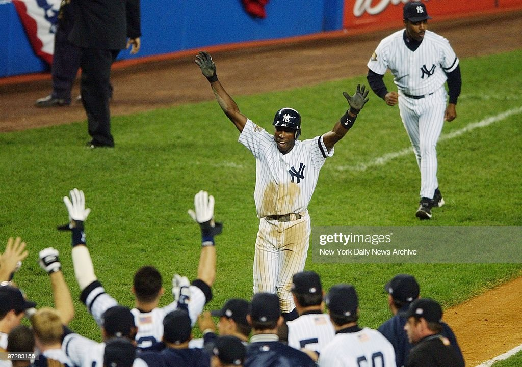 New York Yankees' Alfonso Soriano is greeted by teammates after hitting a two run homer in the ninth inning to win Game 4 of the American League Championship Series against the Seattle Mariners' at Yankee Stadium. The Yanks won the game, 3-1, and maintain their lead in the series, 3-2.