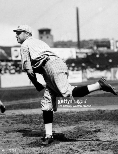 New York Yankees Babe Ruth throwing a pitch circa 1921