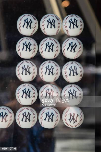 New York Yankees baseball are seen in the window during the street studio as part of Make Music Day New York on June 21 2017 in New York City