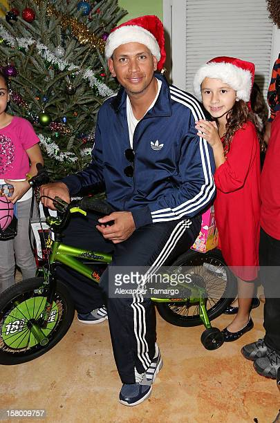 New York Yankees baseball player Alex Rodriguez and his daughter Natasha Rodriguez help deliver toys at Boys and Girls Club Of MiamiDade on December...