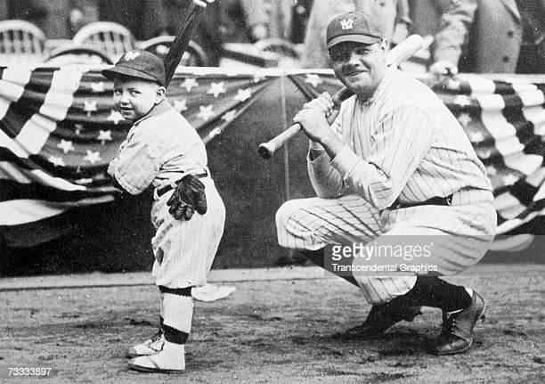 New York Yankees batboy Ray Kelly left poses with Babe Ruth in Yankee Stadium before a game against the Boston Red Sox during Opening Day on April 18...