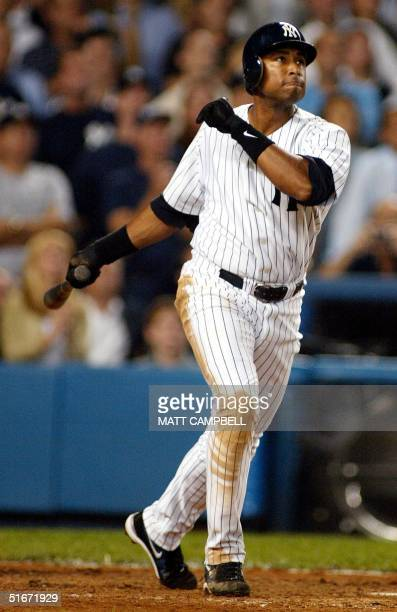 New York Yankee's Bernie Williams hits a two-out, three-run home run in the eighth inning of the first game of the American League Division Series...