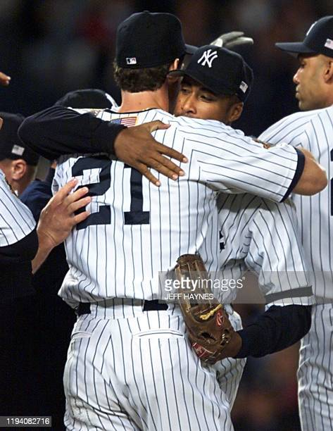 New York Yankees Bernie Williams hugs teammate Paul O'Neill after game five of the American League Championship Series against the Seattle Mariners...