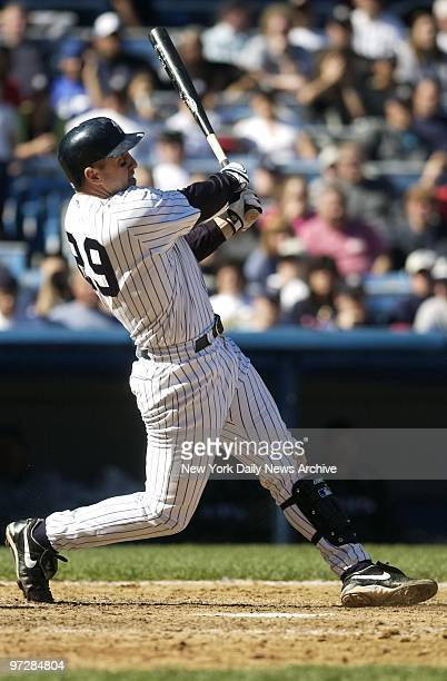 New York Yankees' Bubba Trammell slugs a ball which bounces off the glove of Tampa Bay Devil Rays' outfielder Carl Crawford in the eighth inning of...
