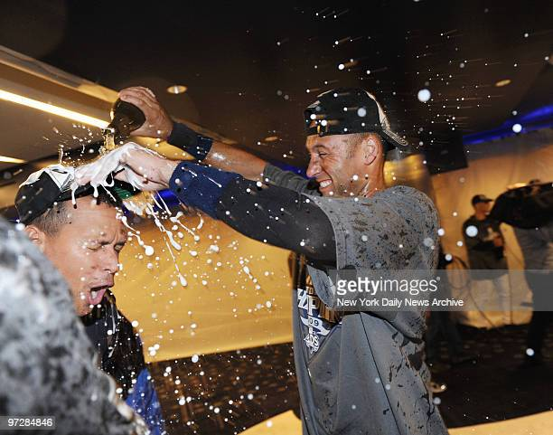 New York Yankees captain Derek jeter douses ARod with champagne after the Bronx Bombers clinched the AL East championship with a threegame sweep of...