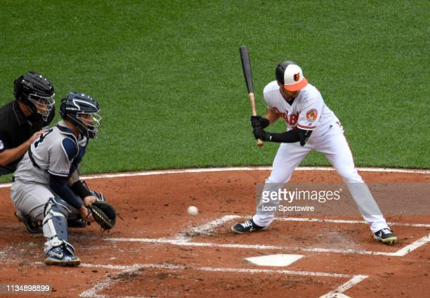New York Yankees catcher Gary Sanchez cannot catch a wild pitch with Baltimore Orioles right fielder Joey Rickard at bat allowing a run to score...