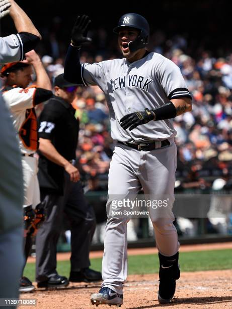 New York Yankees catcher Gary Sanchez celebrates with teammates after hitting a grand slam in the top of the fifth inning during the Major League...