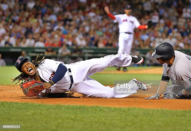 New York Yankees catcher Gary Sanchez collides with Boston Sox first baseman Hanley Ramirez at 1st base in the eighth inning of a game at Fenway Park...