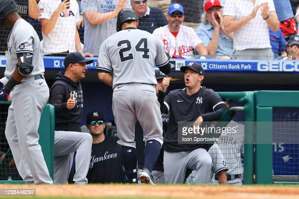 New York Yankees catcher Gary Sanchez congratulated by New York Yankees manager Aaron Boone and New York Yankees pitching coach Matt Blake after...