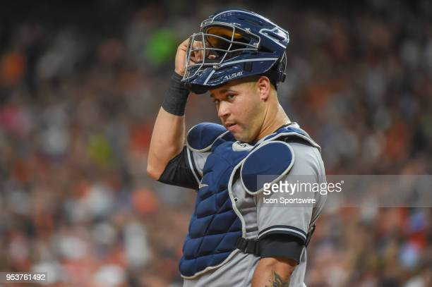 New York Yankees catcher Gary Sanchez looks for a signal from the dugout during the baseball game between the New York Yankees and Houston Astros on...