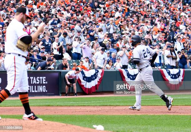 New York Yankees catcher Gary Sanchez rounds the bases after hitting a home run against Baltimore Orioles starting pitcher David Hess on April 7 at...