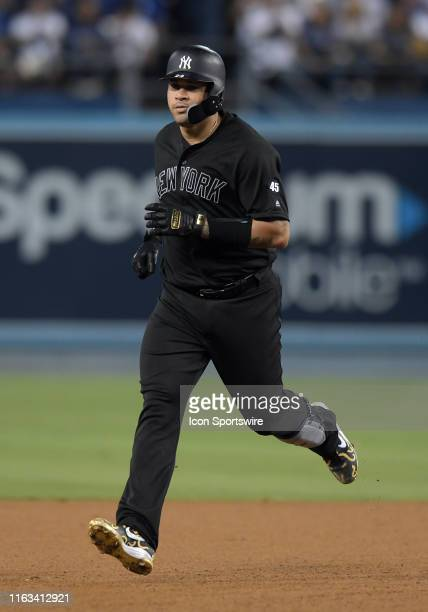 New York Yankees catcher Gary Sanchez rounds the bases after hitting a solo home run in the third inning of a game against the Los Angeles Dodgers...