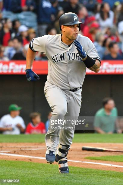 New York Yankees catcher Gary Sanchez runs to first during a MLB game between the New York Yankees and the Los Angeles Angels of Anaheim on April 28...