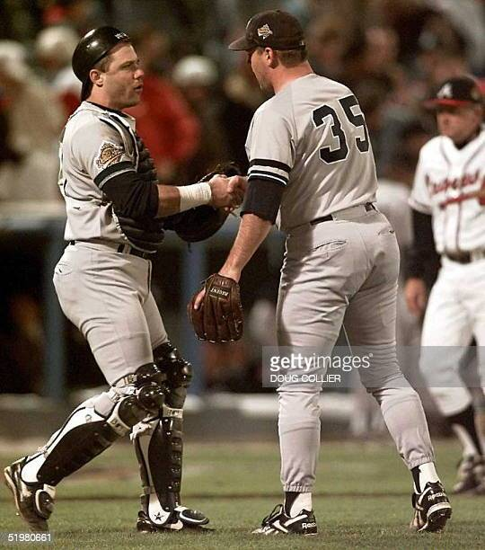 New York Yankees catcher Jim Leyritz and pitcher John Wetteland shake hands after the final out in Game Four of the World Series at Fulton County...