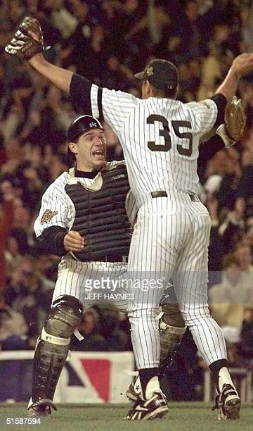 New York Yankees catcher Joe Girardi and pitcher John Wetteland celebrate after the final out 26 October in game six of the World Series against the...