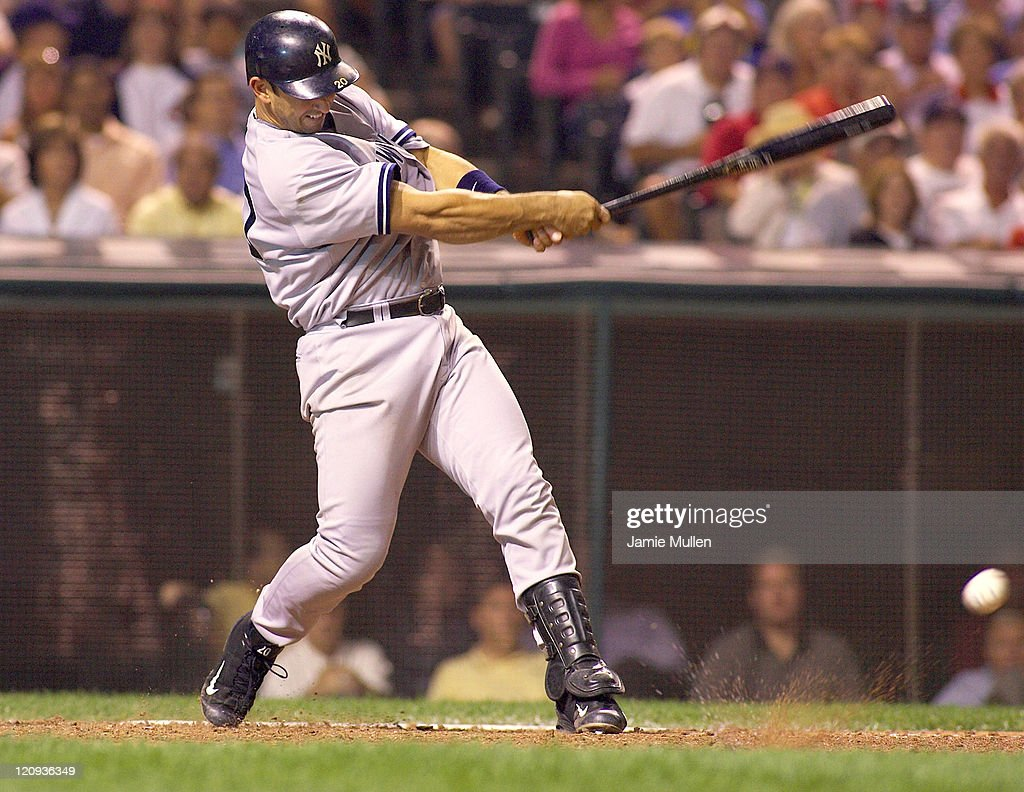 New York Yankees' catcher Jorge Posada bats during the game against the Cleveland Indians Monday August 23, 2004 in Jacobs Field in Cleveland, Ohio. The Yankees won the game 6-4.