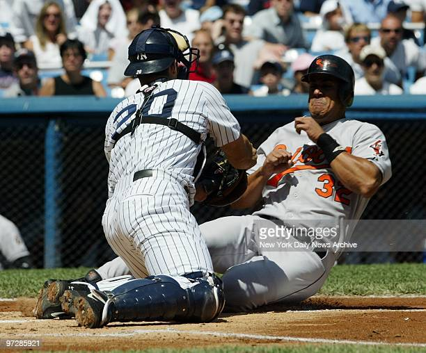 New York Yankees' catcher Jorge Posada puts the tag on the Baltimore Orioles' Luis Matos in the first inning of a game at Yankee Stadium. The Yanks...