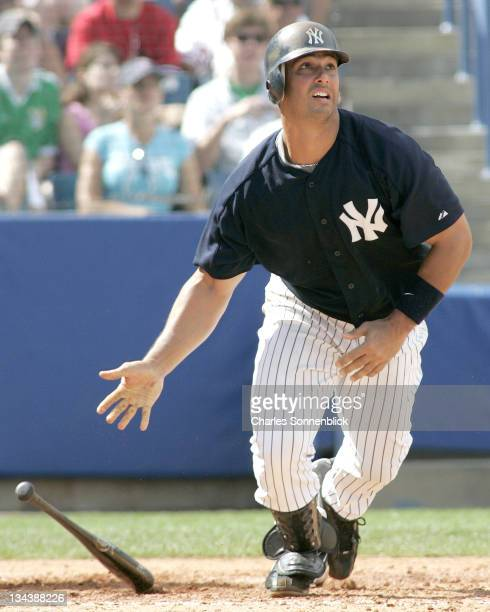 New York Yankees catcher Jorge Posada watches his grand slam homerun which put the Yankees up 60 in a spring training game against the Atlanta Braves...