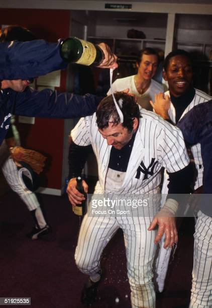 New York Yankees' catcher Thurman Munson celebrates in the clubhouse after winning the World Series against the Los Angeles Dodgers at Yankee Stadium...
