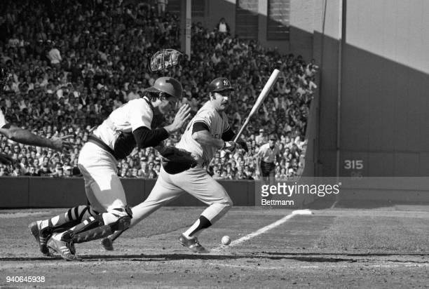 New York Yankees catcher Thurman Munson takes off bat in hand as Red Sox catcher Carlton Fisk dropped the third strike in the 3rd inning of the...