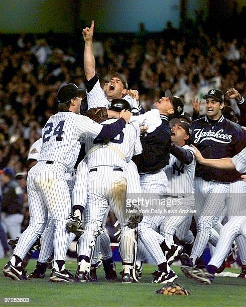 New York Yankees celebrate after beating the Atlanta Braves 32 in Game 6 to win the 1996 World Series