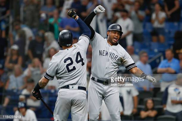 New York Yankees center fielder Aaron Hicks celebrates with Gary Sanchez after hitting a solo home run in the 9th inning of the MLB game between the...
