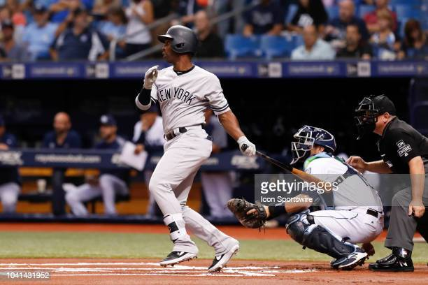 New York Yankees center fielder Andrew McCutchen singles in the 1st inning of the regular season MLB game between the New York Yankees and Tampa Bay...