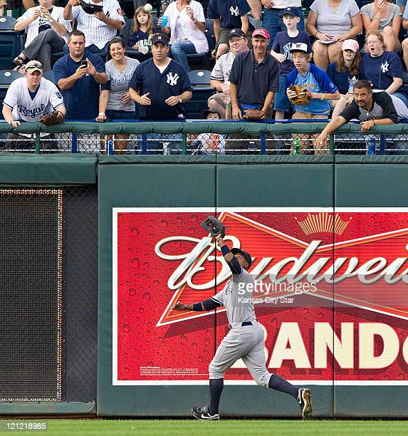 New York Yankees center fielder Curtis Granderson chases down a fly ball for an out on Kansas City Royals' Melky Cabrera in the first inning during...
