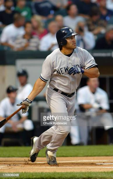 New York Yankees' centerfielder Johnny Damon triples leading off the game against the Chicago White Sox August 9 2006 at US Cellular Field in Chicago...
