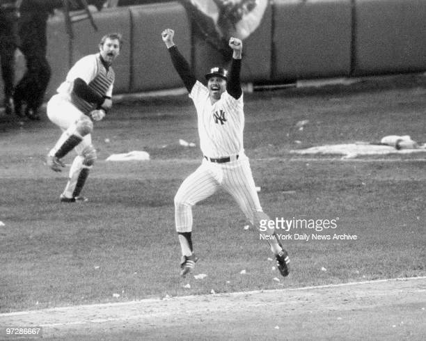 New York Yankees' Chris Chambliss jumps for joy after connecting on the first pitch from Mark Littell of the Kansa City Royals in the bottom of the...