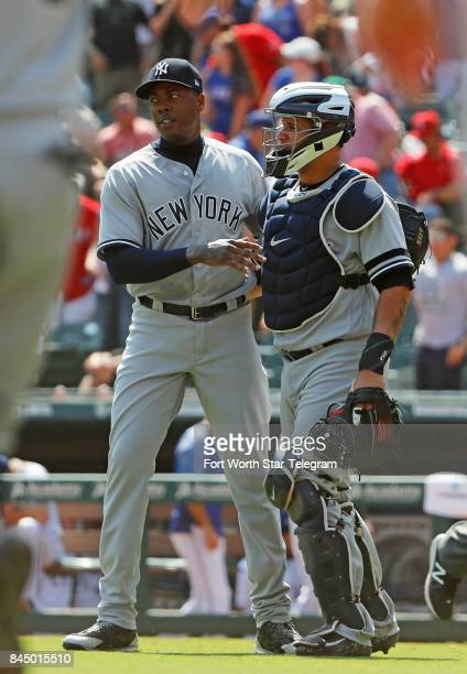 New York Yankees closer Aroldis Chapman left with catcher Gary Sanchez after the final out in a 31 win against the Texas Rangers at Globe Life Park...