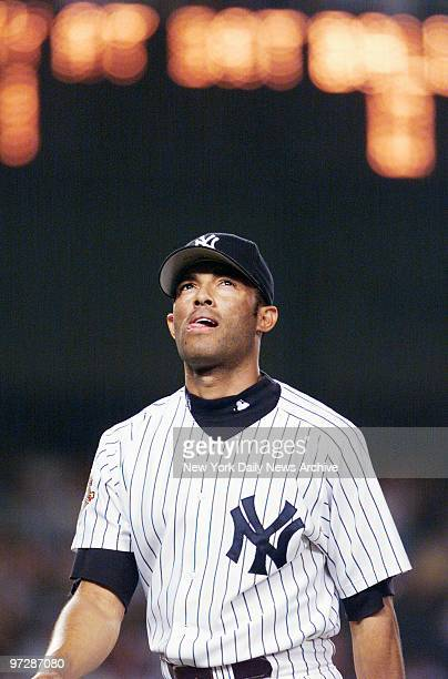 New York Yankees' closer Mariano Rivera looks up as he walks off the mound after retiring the side in the ninth inning but not before giving up a...