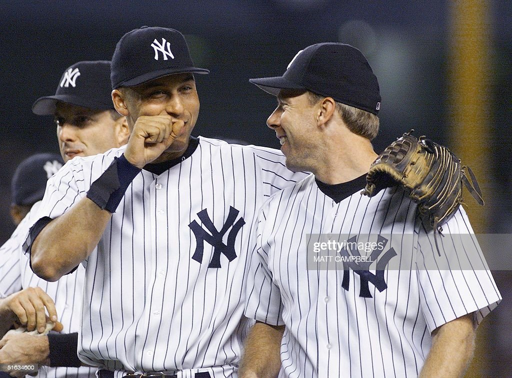 New York Yankees Derek JeterL And Scott BrosiusR Embrace