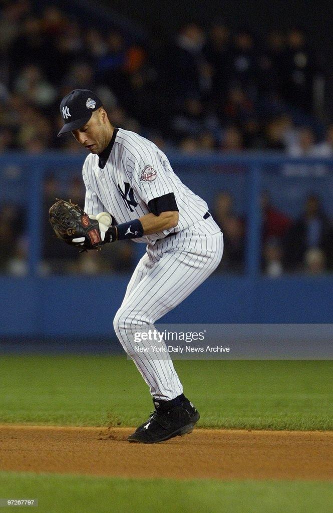 New York Yankees Derek Jeter Bobbles A Ball Hit By Florida Marlins Jeff Conine