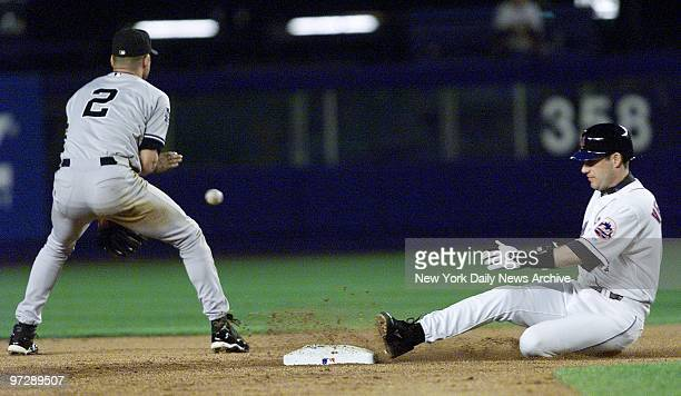 New York Yankees' Derek Jeter can't make the out as New York Mets' Robin Ventura slides safely into 2nd base after hitting a double during Game 3 of...