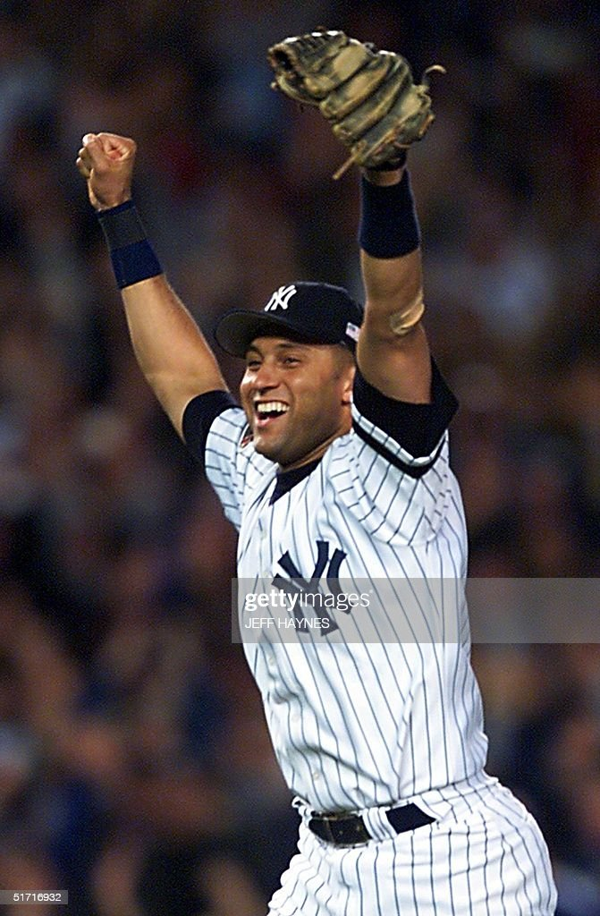 New York Yankees Derek Jeter Celebrates After Game Five Of The American League Championship Series Against