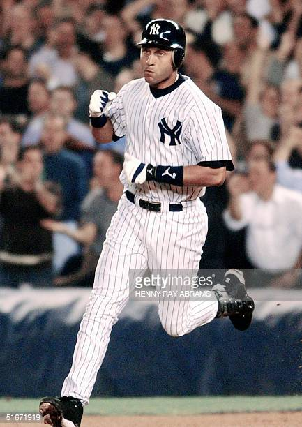 New York Yankees' Derek Jeter celebrates as he rounds the bases after hitting a home run in the first inning against the Anaheim Angels in the first...