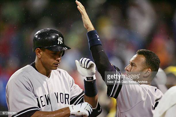 New York Yankees' Derek Jeter congratulates Alex Rodriguez on his solo homer for the goahead run with two strikes and two outs in the top of the...