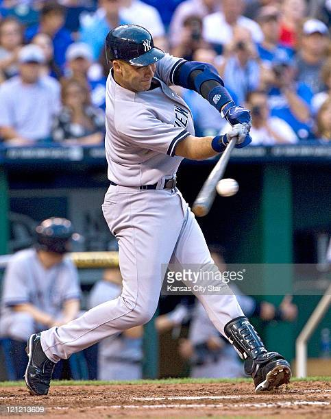 New York Yankees' Derek Jeter connects on an RBI single in the second inning to score Jorge Posada during Monday's baseball game against the Kansas...