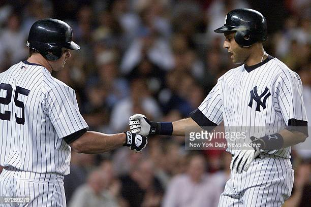 New York Yankees' Derek Jeter is congratulated by Jason Giambi after hitting a solo homer in the fifth inning against the Kansas City Royals at...