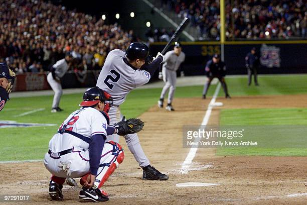 New York Yankees' Derek Jeter singles in the eighth inning to score Scott Brosius from third base during Game 1 of the World Series against the New...