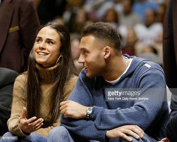 New York Yankees' Derek Jeter sits courtside with girlffriend Jordana Brewster as they watch the New Jersey Nets take on the Los Angeles Lakers at...