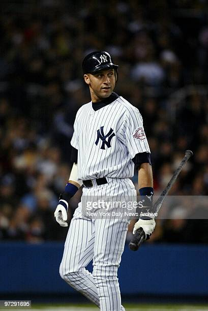New York Yankees' Derek Jeter walks off after he struck out looking in the second inning of Game 6 of the World Series against the Florida Marlins at...
