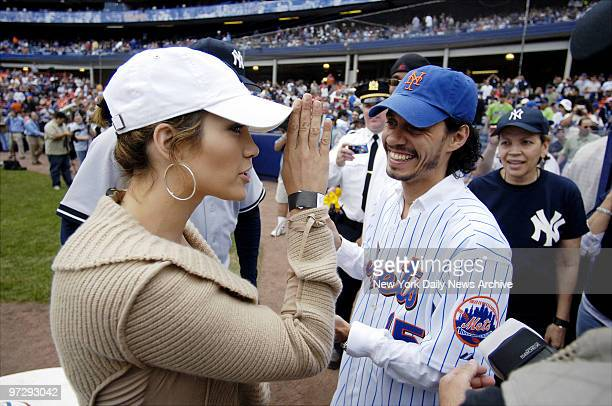 New York Yankees' fan Jennifer Lopez and her husband New York Mets' fan Marc Anthony are on hand for Game 2 of a threegame Subway Series at Shea...