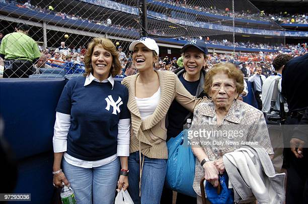 New York Yankees' fan Jennifer Lopez takes mom Guadalupe her cousin and her grandmother to Shea Stadium to enjoy Game 2 of a threegame Subway Series...