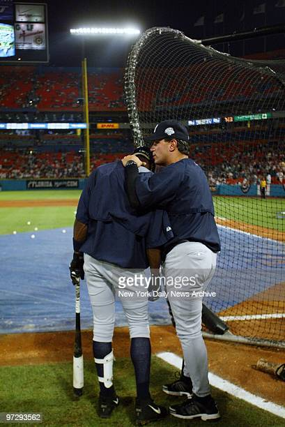 New York Yankees' first base coach Lee Mazzilli comforts infielder Alfonso Soriano at the batting cage during practice before start of Game 5 of the...