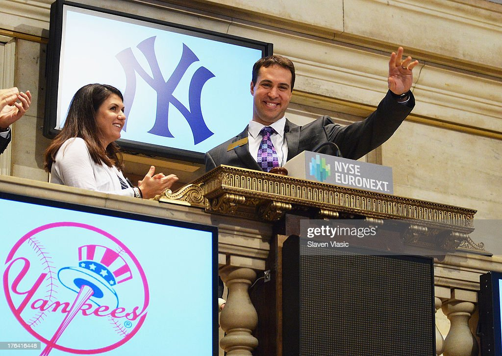 New York Yankees' First Baseman Mark Teixeira rings the opening bell at New York Stock Exchange on August 12, 2013 in New York City.