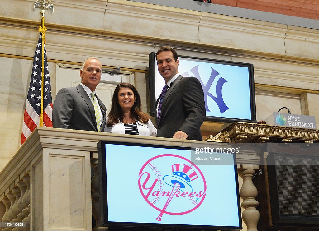 New York Yankees' First Baseman Mark Teixeira (R) rings the opening bell at New York Stock Exchange on August 12, 2013 in New York City.